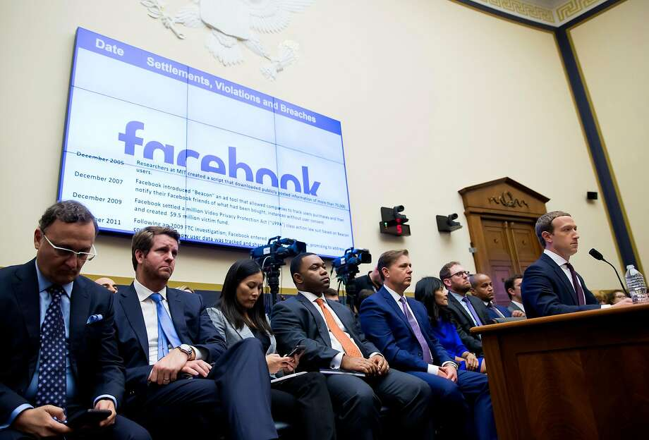 Mark Zuckerberg, the Facebook chief executive, testifies before the House Financial Services Committee in October. Just before Thanksgiving, Facebook rolled out something to help its workers: a chatbot that would teach them official company answers for dealing with thorny questions. Photo: Eric Thayer / New York Times