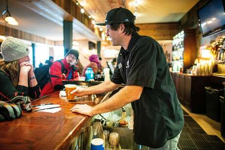 Cory Brown, a bartender, serves guests during a storm at Sierra At Tahoe Resort, Calif. on December 4th, 2019. Photo: AJ Marino / Special To The Chronicle
