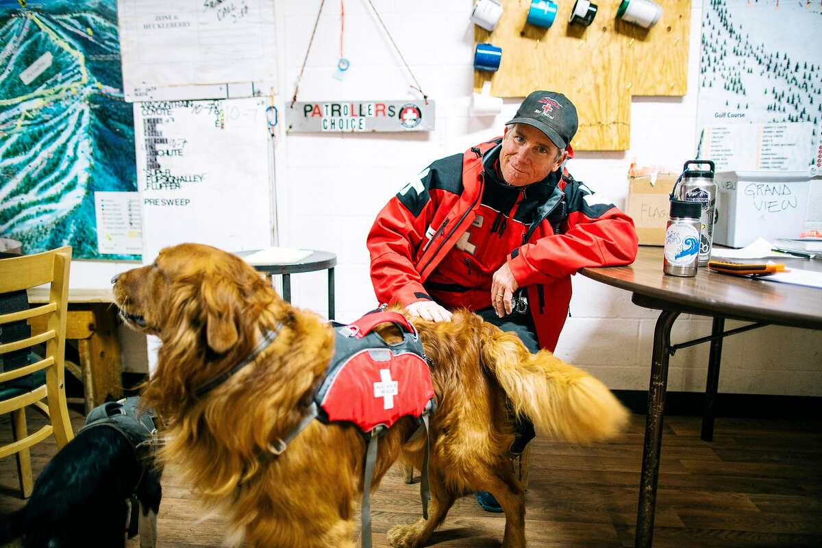 Sierra At Tahoe Ski Patroller, Colin Hupp and his avalanche dog take a break from the storm at Sierra At Tahoe Resort, Calif. on December 4th, 2019.