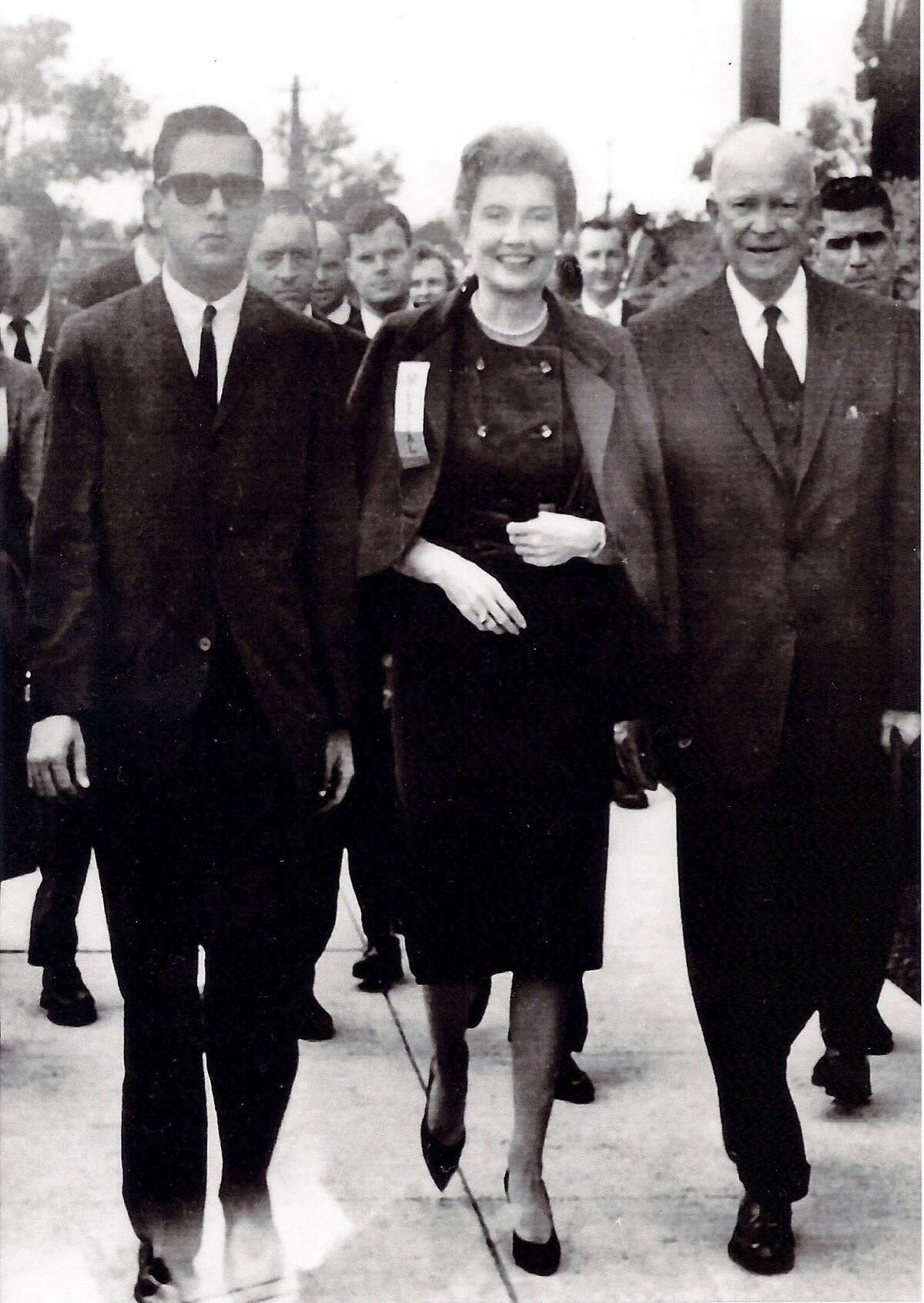 Texas philanthropist Flora Cameron Crichton walks with President Dwight Eisenhower who asked her to be involved in writing the Republican party's national platform.