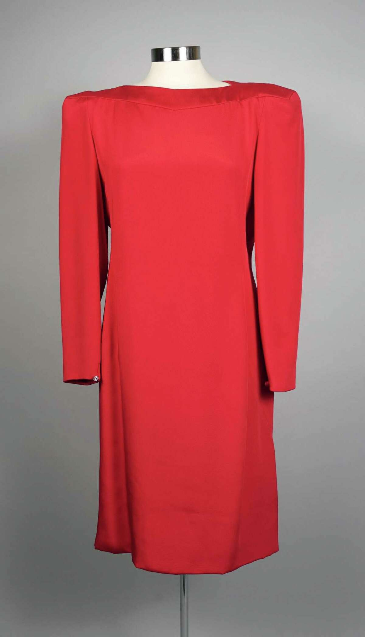A Carolina Herrera red silk dress is one of the items from the collection of philanthropist Flora Cameron Crichton included in the internet auction and estate sale to benefit the Flora Cameron Foundation.