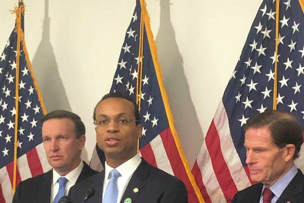 Connecticut Treasurer Shawn Wooden is flanked by Sens. Chris Murphy, left, and Richard Blumenthal.