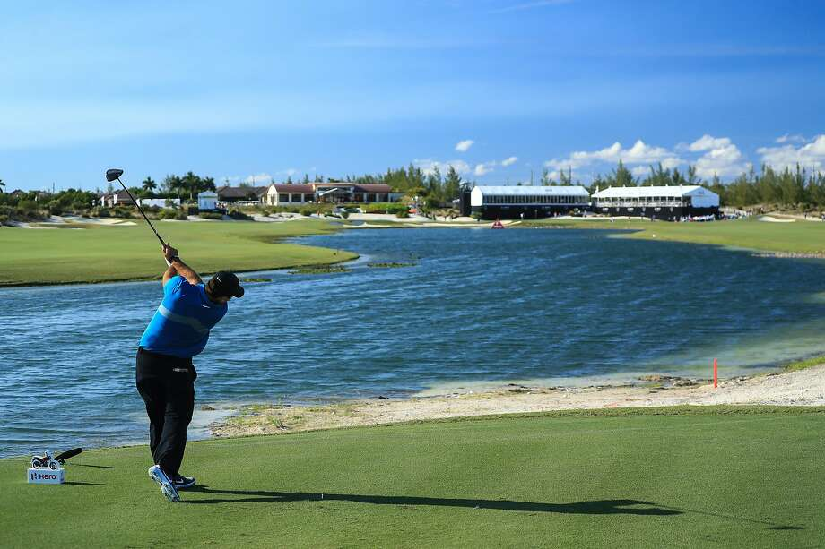 Patrick Reed launches tee shot on the 18th hole during the 2019 Hero World Challenge in Nassau, Bahamas. Photo: David Cannon / Getty Images