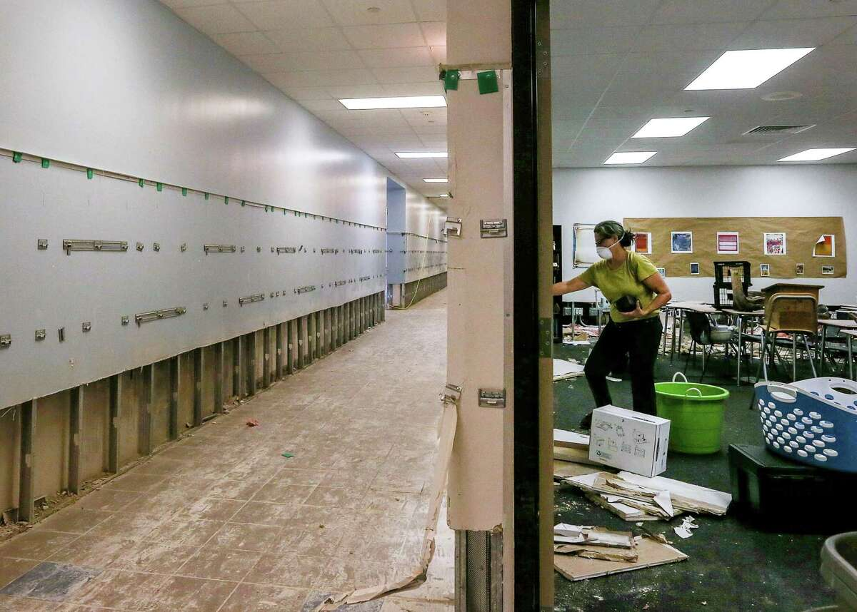 Dee Julian, an AP English teacher from Kingwood High School, removes teaching supplies and a few personal items from her former second-floor classroom at Kingwood High School, Friday, Sept. 8, 2017, in Humble following Hurricane Harvey's devastating deluge over the Houston area. ( Jon Shapley / Houston Chronicle )
