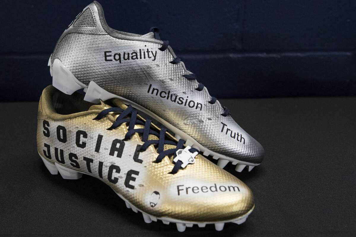 Houston Texans defensive back Keion Crossen's cleats, to raise awareness for social justice, are shown during the unveiling of the NFL players' My Cause, My Cleats campaign at NRG Stadium on Wednesday, Dec. 4, 2019, in Houston.