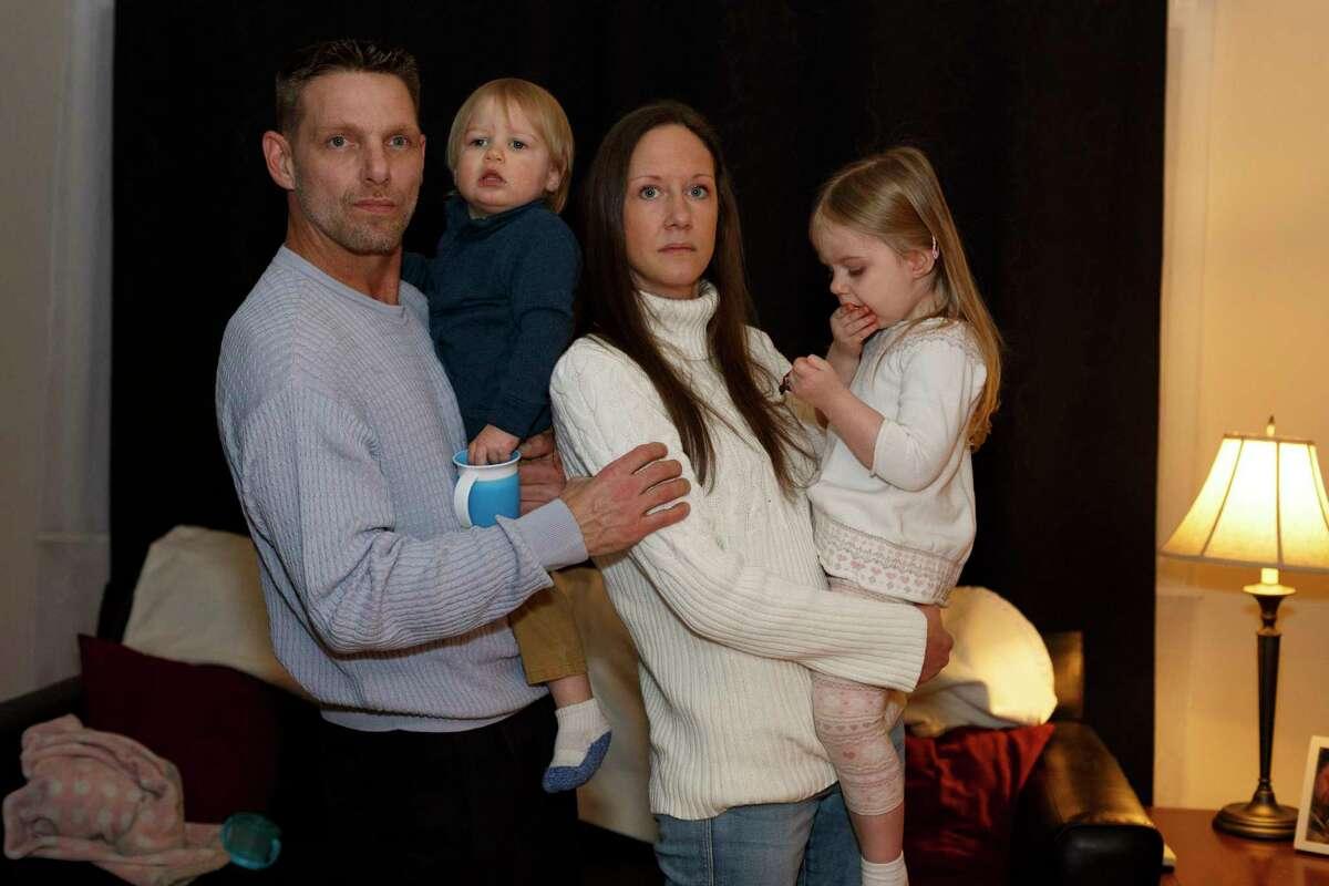 James Parker, 43, Dylan Parker, 1, Allie Parker, 37, and Isabella Parker, 2, at home Dec. 4, 2019 in Westland, Mich.