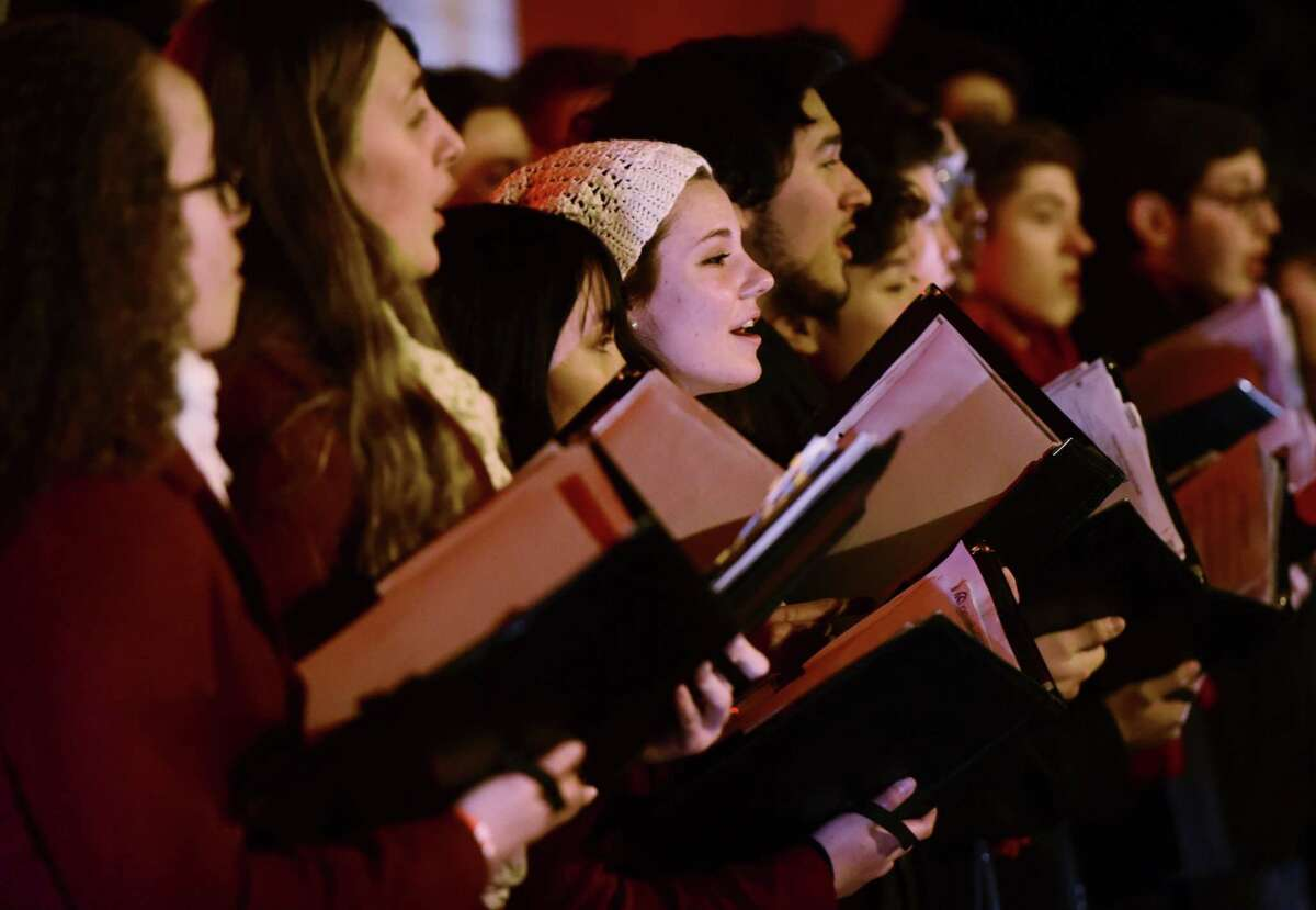 The Brien McMahon High School Chamber Choir sings Christmas Carols for customers and employees celebrating the Stew Leonard's Tree Lighting Wednesday, December 4, 2019, at the flagship store in Norwalk, Conn. It's not just the bare fact that singing can spread disease - the study goes into some detail about which syllables spread the coronaviruses the best (like if, in