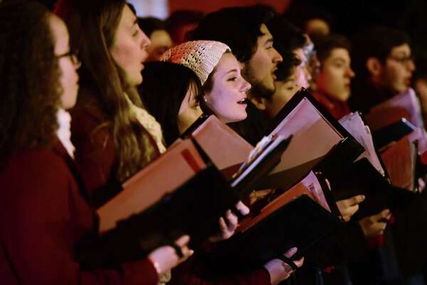 The Brien McMahon High School Chamber Choir sings Christmas Carols for customers and employees celebrating the Stew Leonard's Tree Lighting Wednesday, December 4, 2019, at the flagship store in Norwalk, Conn.