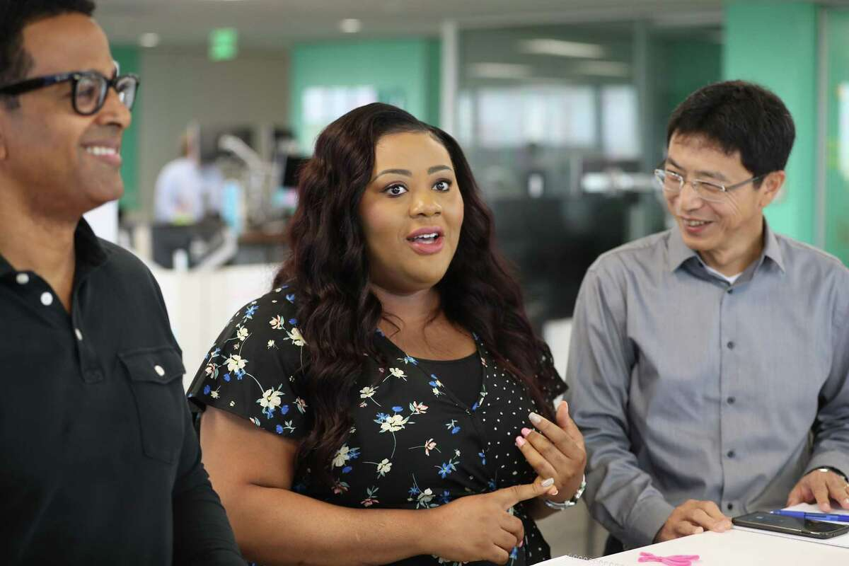 Left to Right: Yared Akalou, Francisca Okenkpu and Dongming Zhang participate in a morning scrum at Enbridge regional headquarters in Houston.