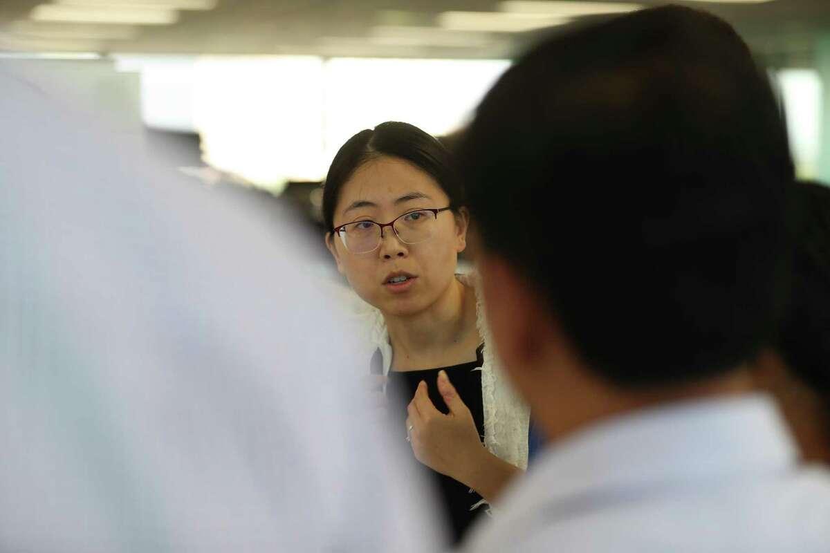Zhijuan Zhang participates in a morning scrum at Enbridge regional headquarters in Houston.