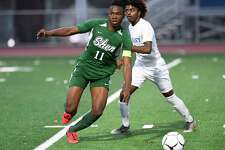 Shenendehowa's Jaylin Sykes (11) moves the ball in front of Albany's Isaiah Harris-Inniss (8) during a Section II Class AA boys' soccer semifinal game in Troy, N.Y., Thursday, Oct. 31, 2019. Shenendehowa won the game 3-0. (Hans Pennink / Special to the Times Union)