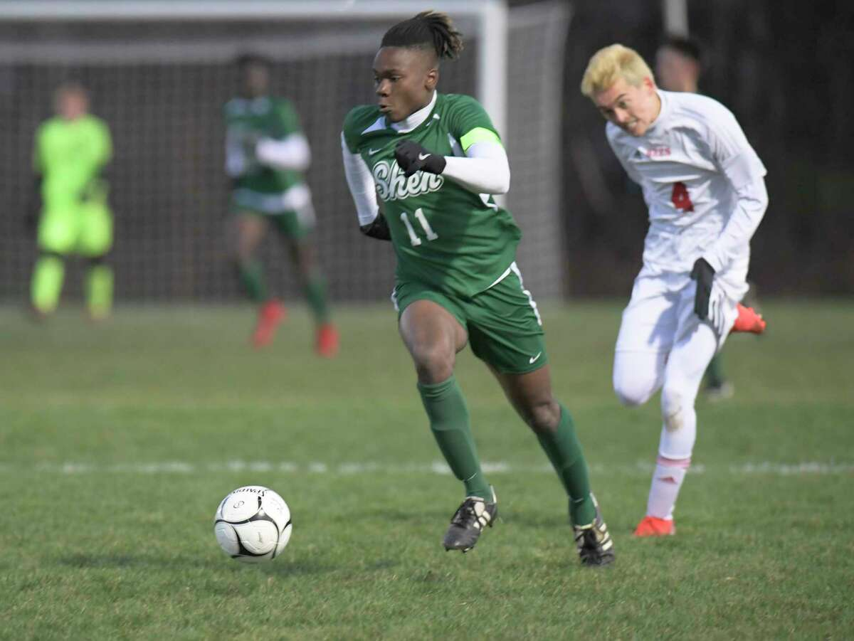 Shenendehowa's Jaylin Sykes (11) moves the ball past Baldwinsville's Geoffrey Tse (4) during a boysA?• Class AA State quarterfinal high school soccer game Saturday, November 9, 2019, in Colonie, N.Y. (Hans Pennink / Special to the Times Union)