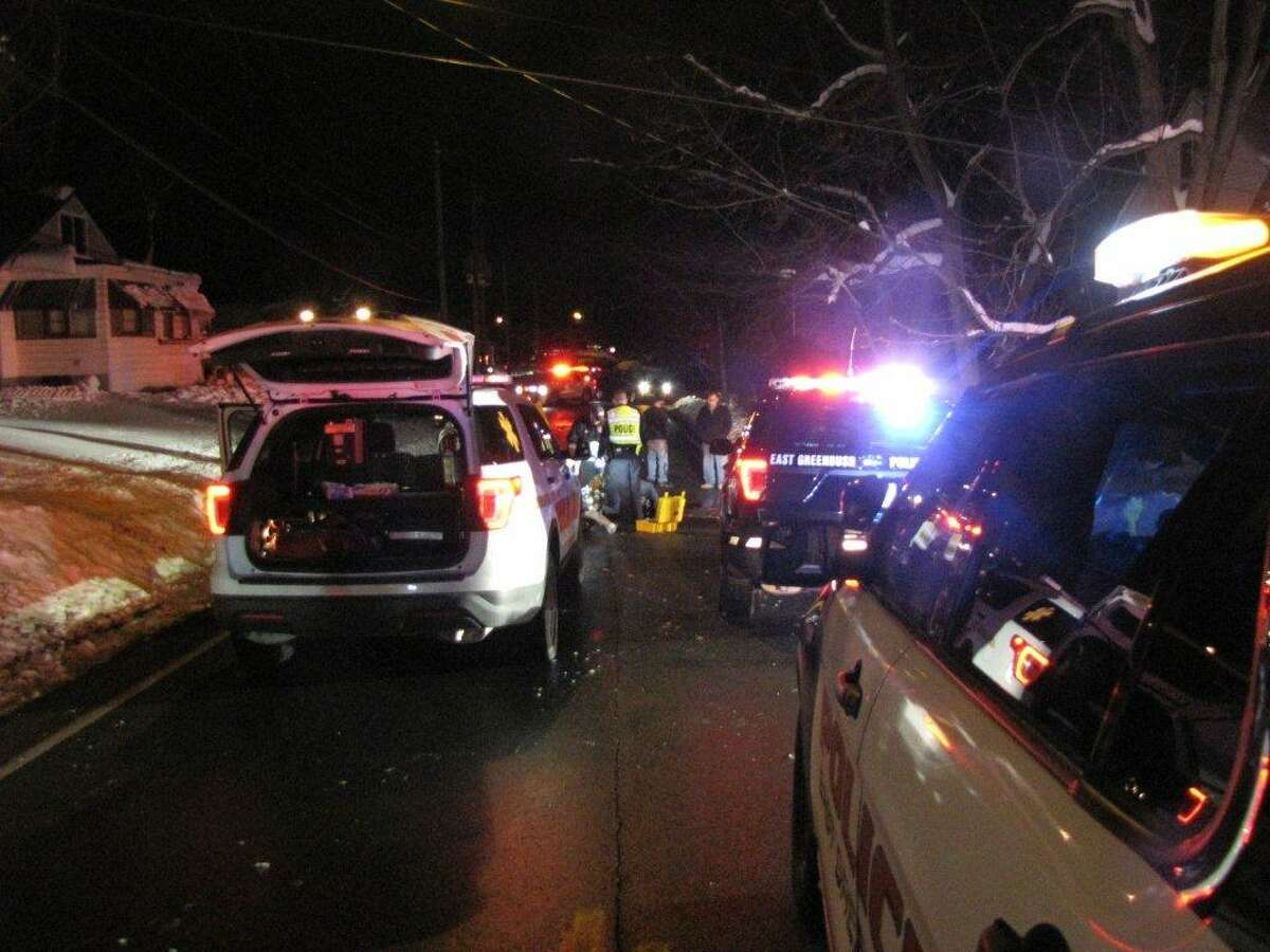 Police respond to the scene of a car-pedestrian collision Wednesday Dec. 4, 2019, in East Greenbush, N.Y.