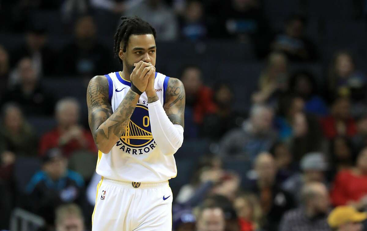 D'Angelo Russell #0 of the Golden State Warriors watches on against the Charlotte Hornets during their game at Spectrum Center on December 04, 2019 in Charlotte, North Carolina. NOTE TO USER: User expressly acknowledges and agrees that, by downloading and or using this photograph, User is consenting to the terms and conditions of the Getty Images License Agreement. (Photo by Streeter Lecka/Getty Images)