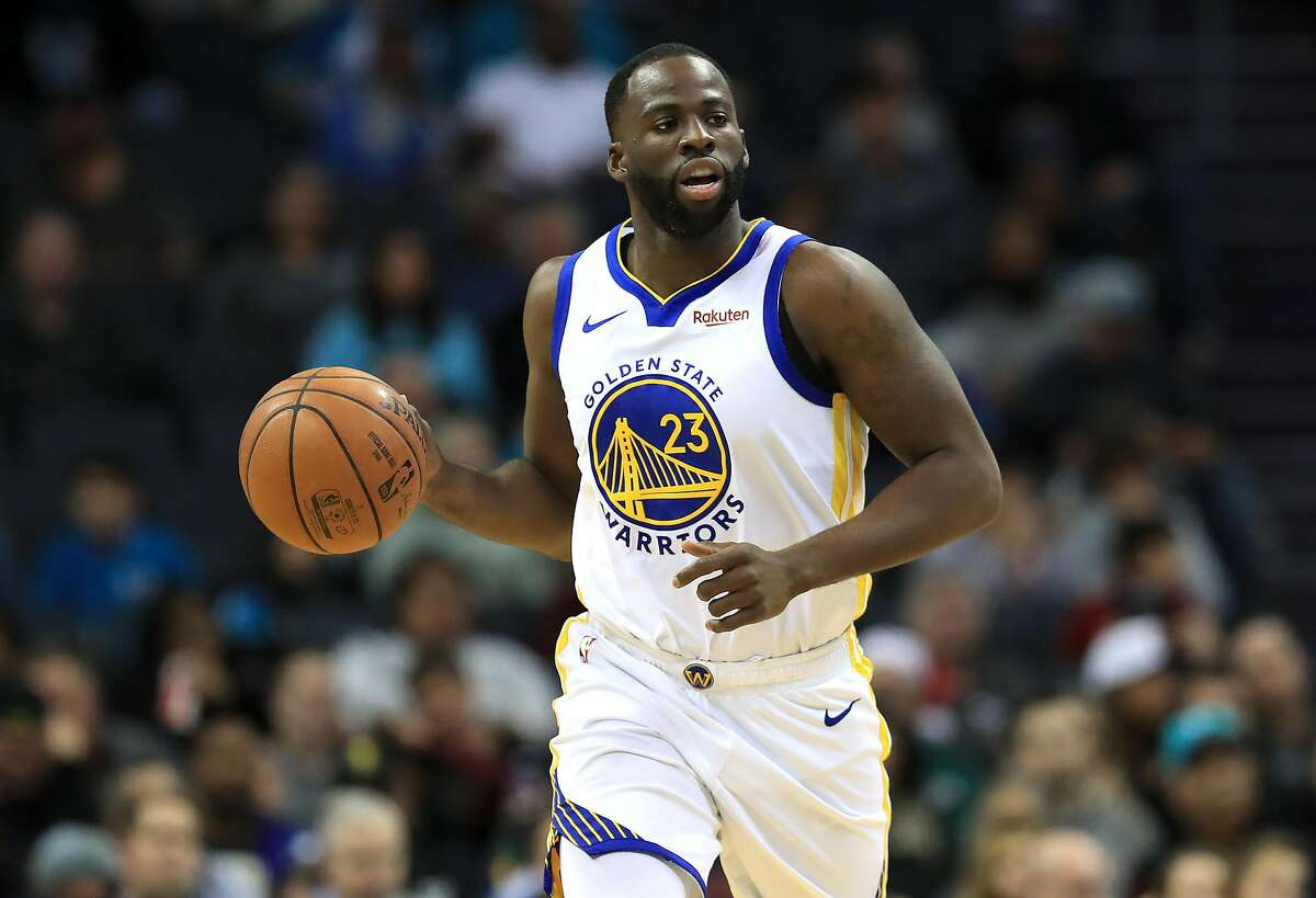 FILE: Draymond Green of the Golden State Warriors brings the ball up the court against the Charlotte Hornets during their game at Spectrum Center on December 4, 2019 in Charlotte, North Carolina.