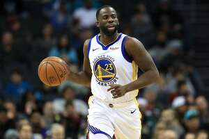 CHARLOTTE, NORTH CAROLINA - DECEMBER 04: Draymond Green #23 of the Golden State Warriors brings the ball up the court against the Charlotte Hornets during their game at Spectrum Center on December 04, 2019 in Charlotte, North Carolina. NOTE TO USER: User expressly acknowledges and agrees that, by downloading and or using this photograph, User is consenting to the terms and conditions of the Getty Images License Agreement. (Photo by Streeter Lecka/Getty Images)