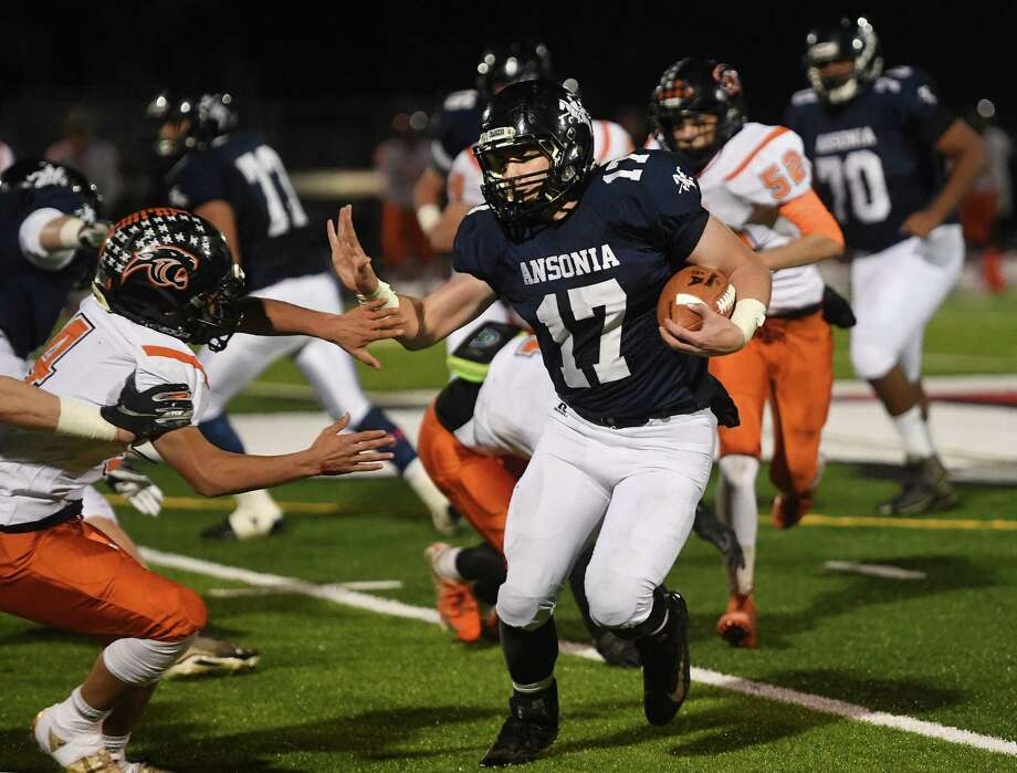 Ansonia runner Tyler Cafaro looks to stiff arm a Plainfield defender as he rushes the ball upfield in the first half of the Chargers' Class S football quartfinal in Derby, Conn. on Wednesday, December 4, 2019. Photo: Brian A. Pounds / Hearst Connecticut Media / Connecticut Post