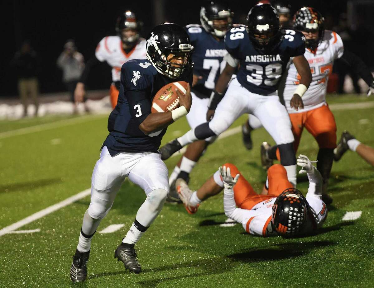 Ansonia tailback Shaykeem Harmon turns the corner and follows his blockers in the first half of the top ranked Chargers' Class S football quartfinal game with Plainfield in Derby, Conn. on Wednesday, December 4, 2019.