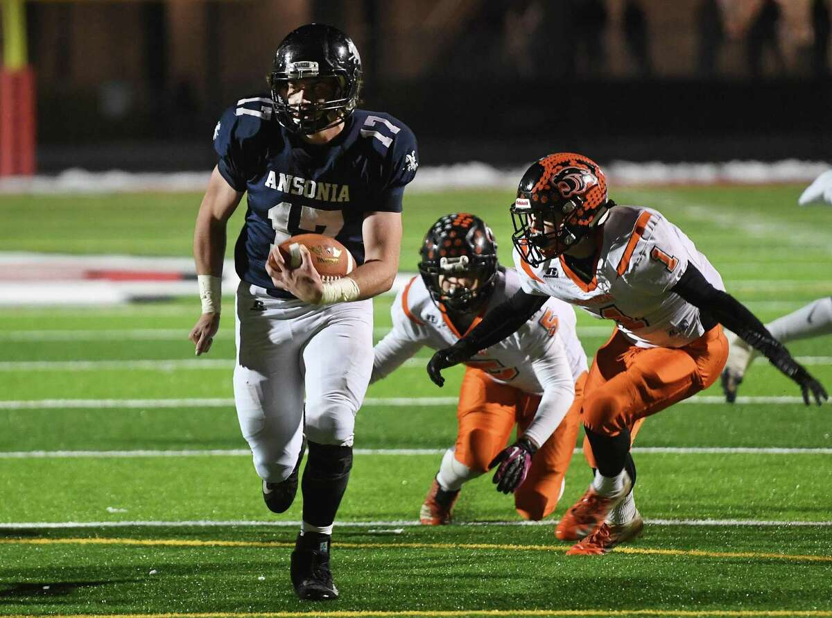 Ansonia's Tyler Cafaro crosses the goal line for a touchdown ahead of two Plainfield defenders in the first half of the Chargers' Class S football quartfinal in Derby, Conn. on Wednesday, December 4, 2019.