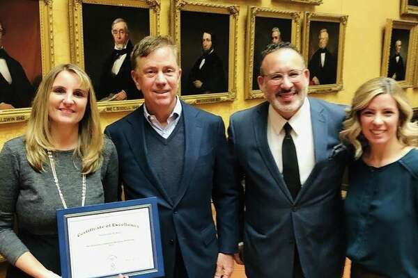 Sunnyside School was recently recognized for its students' performance in the Governor's Summer Reading Challenge. Pictured are Sunnyside School reading consultant Kristen Festa, Gov. Ned Lamont, state Commissioner of Education Miguel Cardona and Sunnyside School Principal Amy Yost.