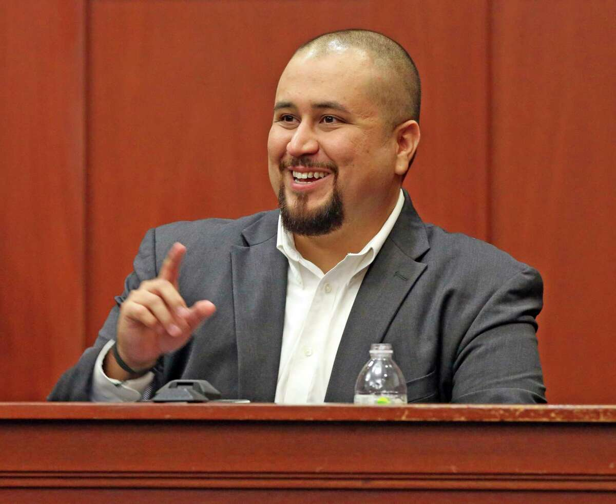FILE- In this Sept. 13, 2016 file photo, George Zimmerman smiles as he testifies in a Seminole County courtroom in Orlando, Fla. Zimmerman, who was acquitted of the 2012 killing of an unarmed black teen Trayvon Martin, has filed a lawsuit, Wednesday, Dec. 4, 2019, against the teens' parents, family attorney and prosecutors who tried his case, claiming they coached a witness to give false testimony. (Red Huber/Orlando Sentinel via AP, Pool, File)