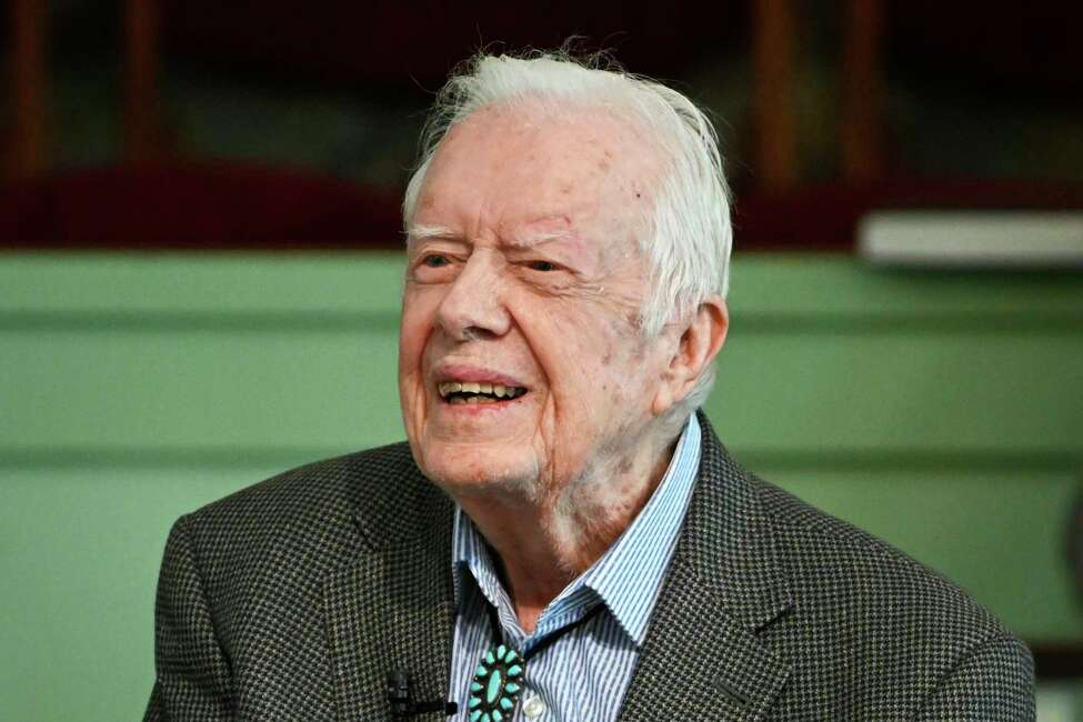 FILE - In this Nov. 3, 2019 file photo, former President Jimmy Carter teaches Sunday school at Maranatha Baptist Church in Plains, Ga. Carter Center spokeswoman Deanna Congileo said the the 95-year-old former U.S. president has been discharged from a hospital, Wednesday, Dec. 4, 2019, after being treated for a urinary tract infection. (AP Photo/John Amis, File)