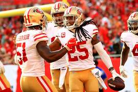 TAMPA, FLORIDA - SEPTEMBER 08: Richard Sherman #25 of the San Francisco 49ers celebrates an interception returned for a touchdown during a game against the Tampa Bay Buccaneers at Raymond James Stadium on September 08, 2019 in Tampa, Florida. ~~