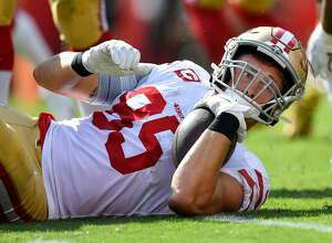 TAMPA, FL - SEPTEMBER 08: San Francisco 49ers Tight End George Kittle (85) looks to see if he was able to get a first down during the first half of the season opener between the San Francisco 49ers and the Tampa Bay Bucs on September 08, 2019, at Raymond James Stadium in Tampa, FL. (Photo by Roy K. Miller/Icon Sportswire via Getty Images)