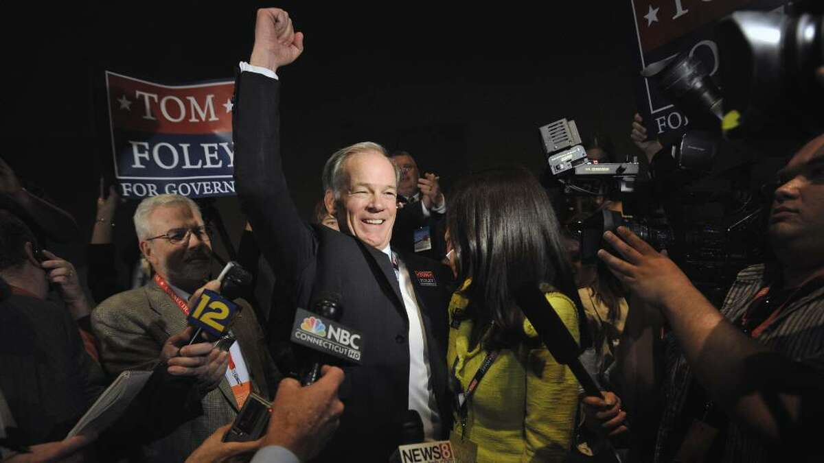 Republican candidate for Governor Tom Foley, center, and wife Leslie Fahrenkopf react after Foley received the nomination at the Connecticut Republican Convention in Hartford, Conn., Saturday, May 22, 2010. (AP Photo/Jessica Hill)