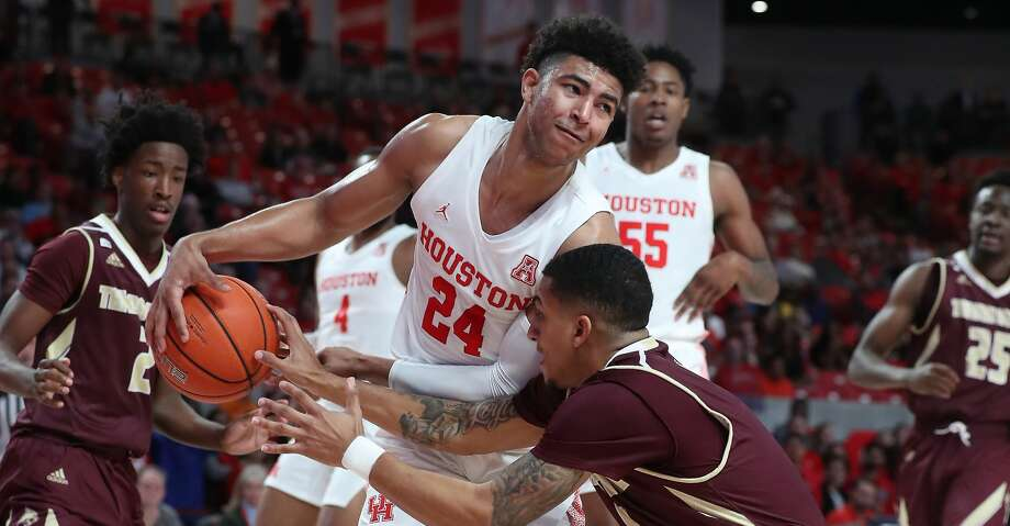 Houston Cougars guard Quentin Grimes (24) receives pressure from Texas State Bobcats guard Marlin Davis (5) during the first half of an NCAA basketball game at Fertitta Center Wednesday, Dec. 4, 2019, in Houston. Photo: Steve Gonzales/Staff Photographer