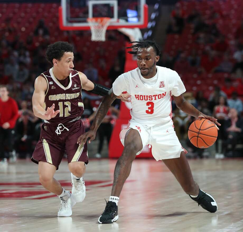 Texas State Bobcats guard Mason Harrell (12) guards Houston Cougars guard DeJon Jarreau (3) during the first half of an NCAA basketball game at Fertitta Center Wednesday, Dec. 4, 2019, in Houston. Photo: Steve Gonzales/Staff Photographer