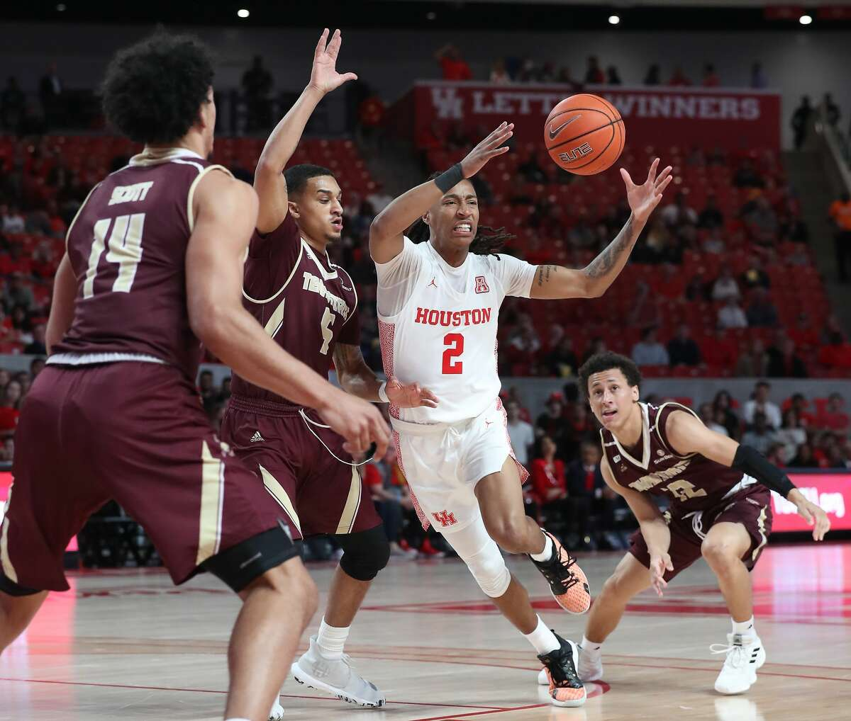 Houston Cougars guard Caleb Mills (2) fights for a loose ball through Texas State Bobcats defenders during the first half of an NCAA basketball game at Fertitta Center Wednesday, Dec. 4, 2019, in Houston.