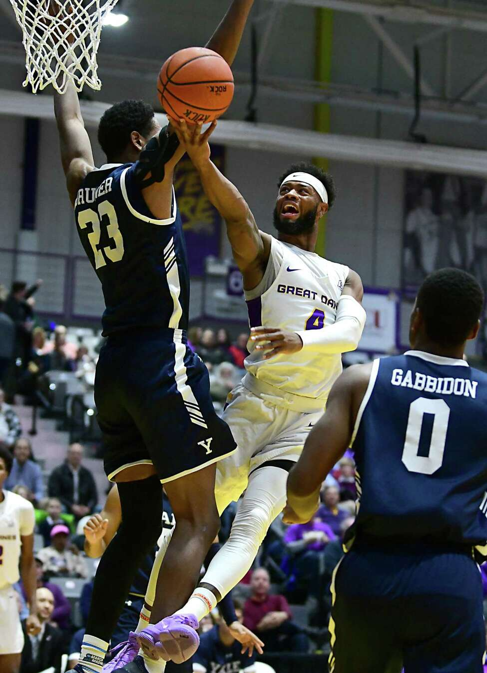 University at Albany's Ahmad Clark drives to the hoop against Yale's Jordan Bruner during a basketball game at SEFCU Arena on Wednesday, Dec. 4, 2019 in Albany, N.Y. (Lori Van Buren/Times Union)