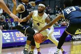 University at Albany's Ahmad Clark has the ball stolen from him by Yale's Jordan Bruner as he drives to the hoop during a basketball game against Yale at SEFCU Arena on Wednesday, Dec. 4, 2019 in Albany, N.Y. (Lori Van Buren/Times Union)