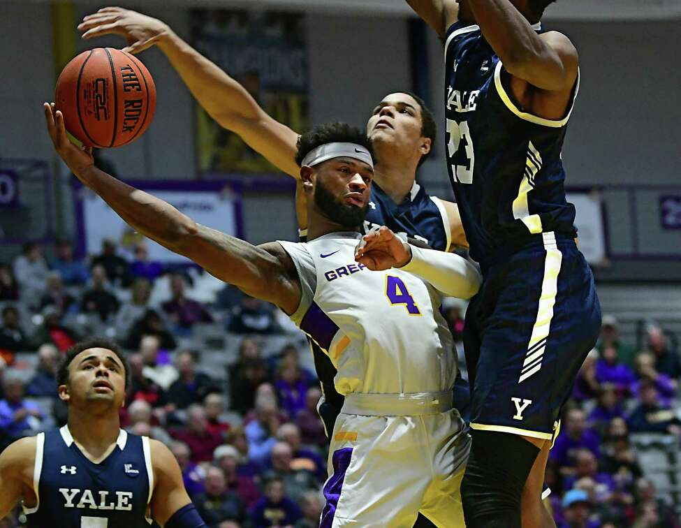 University at Albany's Ahmad Clark has the ball deflected as he tries to pass under the hoop during a basketball game against Yale at SEFCU Arena on Wednesday, Dec. 4, 2019 in Albany, N.Y. (Lori Van Buren/Times Union)