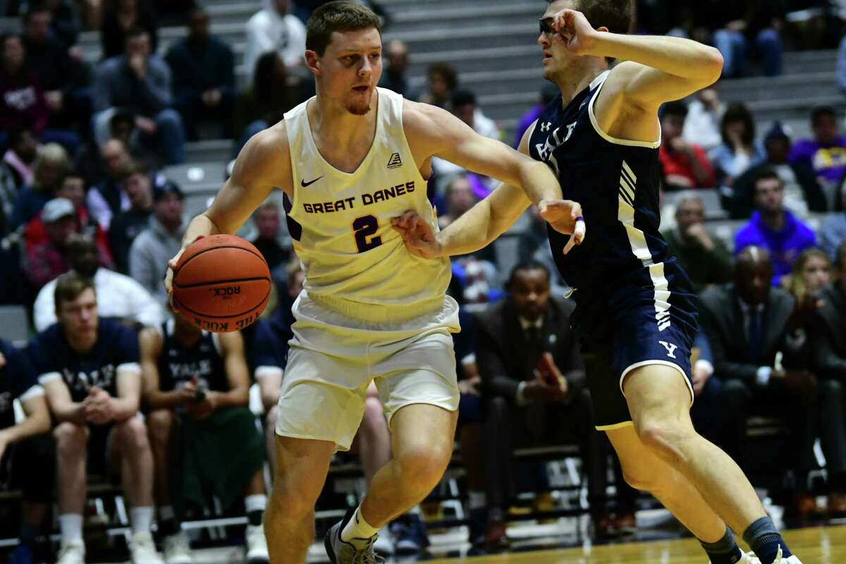University at Albany's Trey Hutcheson drives to the hoop against Yale's Eric Monroe during a basketball game at SEFCU Arena on Wednesday, Dec. 4, 2019 in Albany, N.Y. (Lori Van Buren/Times Union)