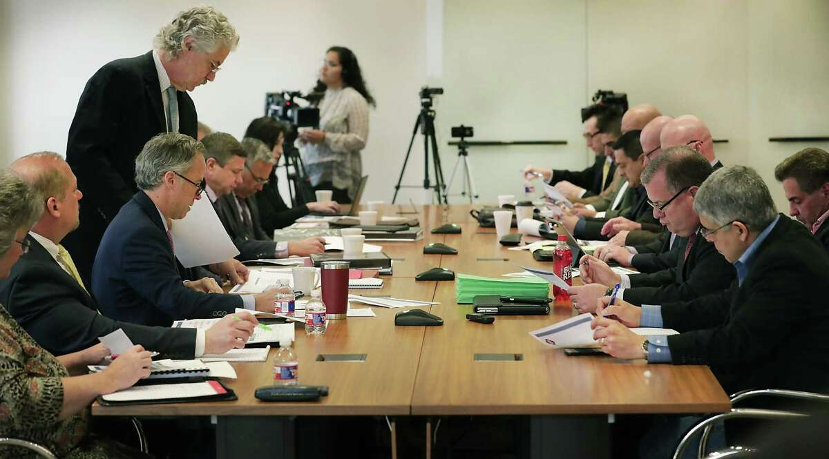 Collective bargaining teams for San Antonio officials, left, and the fire union, right, meet during contract negotiations on Monday, March 18, 2019. In July, the union invoked its right to go into binding arbitration. The two parties have now spent two days in arbitration over the union's contract.