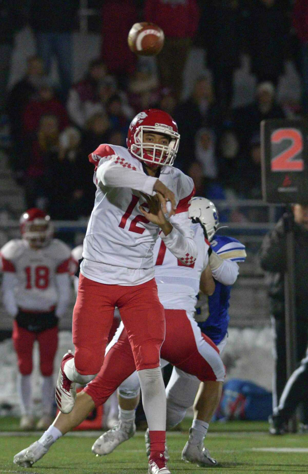 NFA quarterback Jayden Desilus throws a pass in the Class LL State Football Quarterfinal game between No.8 Norwich Free Academy and No. 1 Newtown high schools, Wednesday December 4, 2019, at Newtown High School, Newtown, Conn.