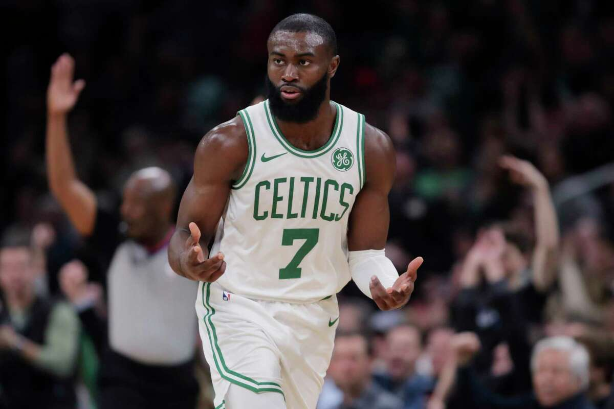 Boston Celtics guard Jaylen Brown (7) celebrates after hitting a 3-pointer during the second half of an NBA basketball game against the Miami Heat in Boston, Wednesday, Dec. 4, 2019. (AP Photo/Charles Krupa)