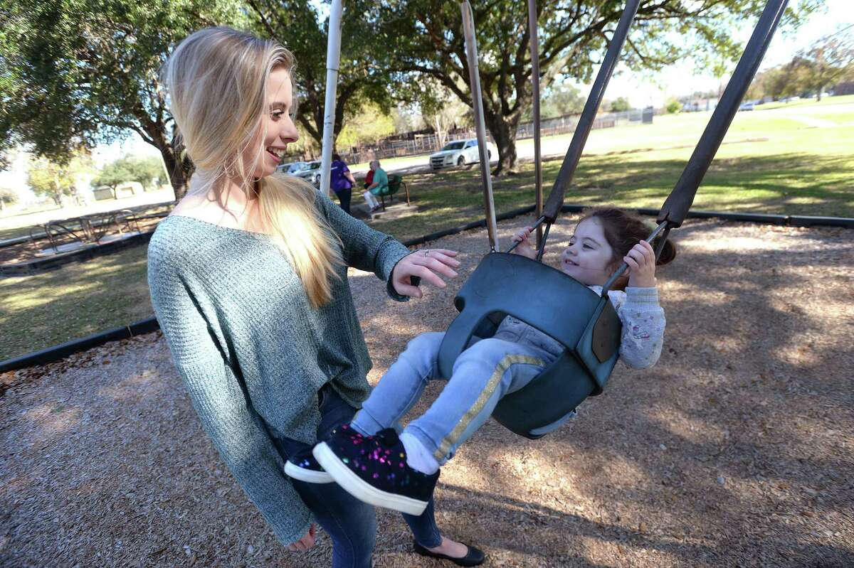Sierra Garcia pushes daughter Isabella Garcia on the swings in Port Neches' Riverside Park Wednesday. The pair had the park, which Garcia says is normally packed, nearly to themselves. With the TPC plant fire now out, life is somewhat returning to normal, but Wednesday morning was the first time SIerra and Isabella had returned to their favorite park to play. The family returned last Saturday to their apartment on 9th Avenue in Port Arthur, which they evacuated even before the order to leave was issued last Wednesday. Garcia says the family, who moved to the area just 3 months ago, have been looking for a home in the Port Neches area, but the recent incident and concerns over air quality and safety have made them rethink a move to the area. They are now considering Lumberton or Beaumont. Photo taken Wednesday, December 4, 2019 Kim Brent/The Enterprise