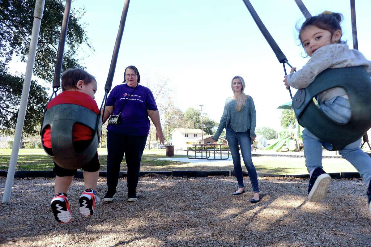 Sierra Garcia (right) talks with Elizabeth Dodson while Dodson's nephew Austin Garcia and Sierra's daughter Isabella Garcia play on the swings in Port Neches' Riverside Park Wednesday. The children had the park to themselves, which Sierra says is unsual compared to most days before last week's explosion and ongoing fire at the nearby TPC Group plant. With the fire now out, life is somewhat returning to normal, but Wednesday morning was the first time SIerra and Isabella had returned to their favorite park to play. Photo taken Wednesday, December 4, 2019 Kim Brent/The Enterprise