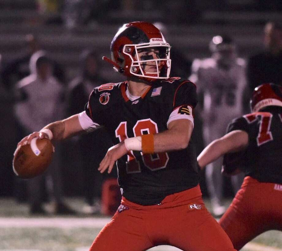 New Canaan High School graduate Drew Pyne saw his first action at quarterback for the University of Notre Dame Saturday, Sept. 19, when the Irish beat the University of South Florida 52-0 in South Bend, Ind. Pyne is pictured getting set to pass against Wethersfield during the Class L football quarterfinals at Dunning Field on Wednesday, Dec. 4, 2019. Photo: David Stewart / Hearst Connecticut Media / Connecticut Post