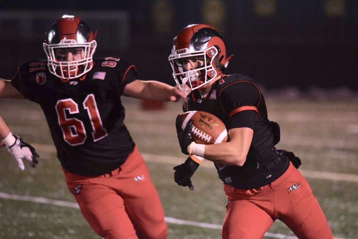 New Canaan's Zach LaPolice (7) gets room to run against Wethersfield with help from Jaden Konspore (61) during the Class L football quarterfinals at Dunning Field on Wednesday, Dec. 4, 2019.