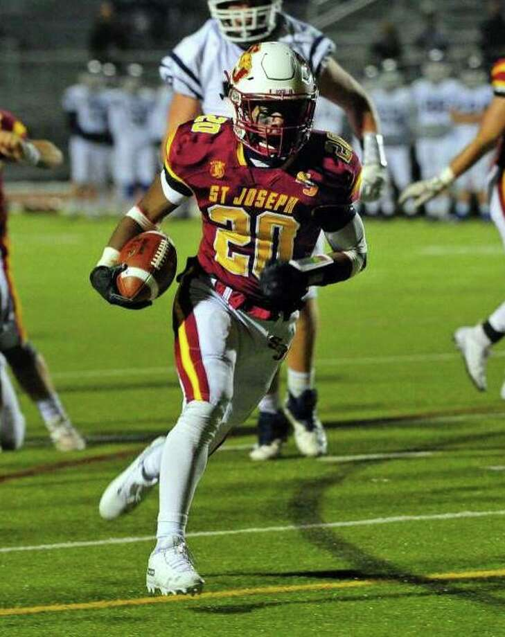 Jaden Shirden rushed for 222 yards and accounted for six touchdowns in St. Joseph's Class L quarterfinal win. Photo: Christian Abraham / Hearst Connecticut Media / Trumbull Times