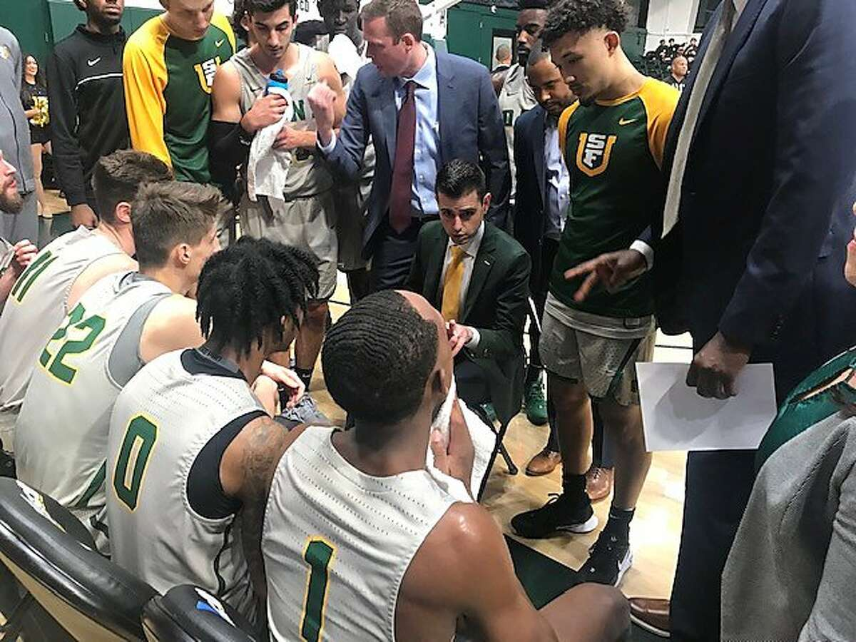 Todd Golden talks to his USF players during a first-half timeout in their game against Cal.
