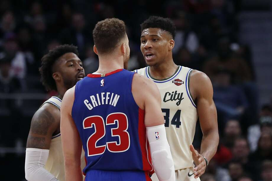 Pistons forward Blake Griffin and Bucks forward Giannis Antetokounmpo exchange words after a foul in the first half. Photo: Carlos Osorio / Associated Press
