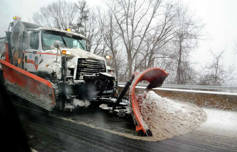A state snow plow clears a lane of Route 8 in Derby, Conn., on Tuesday, Feb. 12, 2019. Photo: Christian Abraham / Hearst Connecticut Media / Connecticut Post