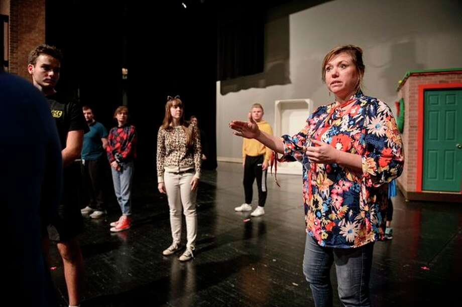 """Karla Kash, SVSU assistant professor of theater, directs the cast during a rehearsal for the upcoming """"Home For The Holidays: A Holiday Variety Show!"""" performance. (Photo by Tim Inman, SVSU)"""