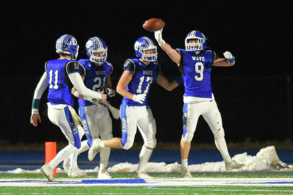 Darien defeats Greenwich 26-16 in a CIAC Class LL football quarterfinal game at Darien High School in Darien, Conn. on Dec. 4, 2019.