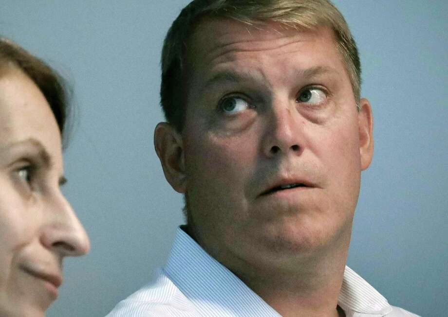 FILE - In this Aug. 20, 2019 file photo, Scott Hapgood, right, a U.S. financial adviser charged with killing a hotel worker while on vacation in Anguilla, and his lawyer Juliya Arbisman, left, hold a media conference in New York. Hapgood declined to return to the British Caribbean territory for the latest pretrial hearing on Monday, Nov. 11, and Anguilla officials rejected an offer that he appear by video link for the hearing. (AP Photo/Bebeto Matthews, File) Photo: Bebeto Matthews / Associated Press / Copyright 2019 The Associated Press. All rights reserved.